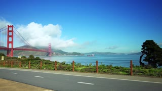 People ride bikes on road near Golden Gate Bridge and San Francisco bay 4