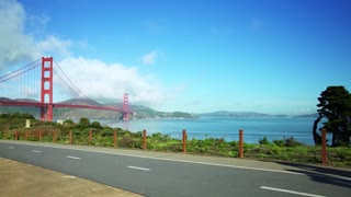 People ride bikes on road near Golden Gate Bridge and San Francisco bay 5