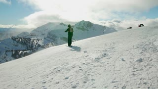 Person begins to ski down a mountain 2