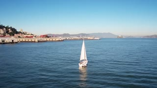 Sailboat crosses water by San Francisco skyline 4