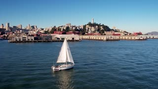 Sailboat crosses water by San Francisco skyline 6