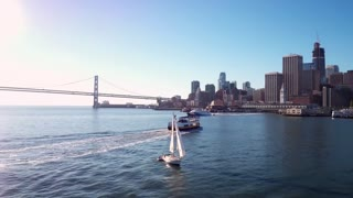 Sailboat crosses water by San Francisco skyline