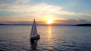 Sailboat floats in water by beautiful sunset 3