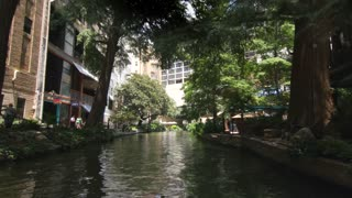 San Antonio riverwalk view going under bridge on sunny day 10