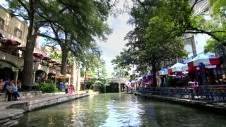 San Antonio riverwalk view going under bridge on sunny day 11