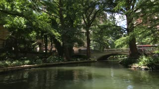 San Antonio riverwalk view going under bridge on sunny day 3