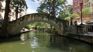 San Antonio riverwalk view going under bridge on sunny day 4