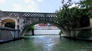 San Antonio riverwalk view going under bridge on sunny day 6