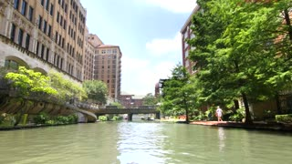 San Antonio riverwalk view going under bridge on sunny day 7