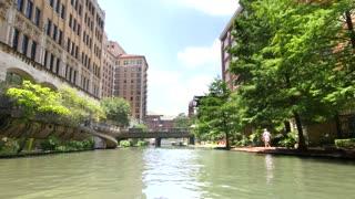 San Antonio riverwalk view going under bridge on sunny day 7