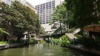 San Antonio riverwalk view going under bridge on sunny day 8