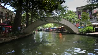 San Antonio riverwalk view going under bridge on sunny day 9