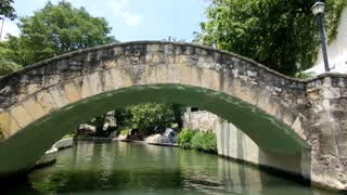 San Antonio riverwalk view going under bridge on sunny day