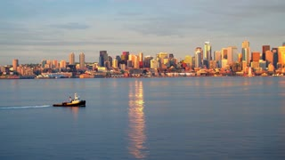 Ship crosses water next to Seattle skyline 2