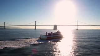 Ship travels by Oakland Bay Bridge 2