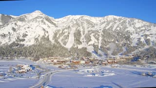 Snow covered village with beautiful mountains and blue sky 3