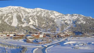Snow covered village with beautiful mountains and blue sky 4