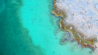 Tropical Dock over Rocks in Paradise from Aerial Drone 3
