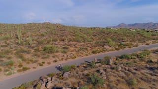 A Biker on a Single Road Through the Desert