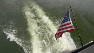 American Flag Behind a Boat
