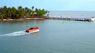 Boats Crossing in Tropical Resort Town by Aerial Drone