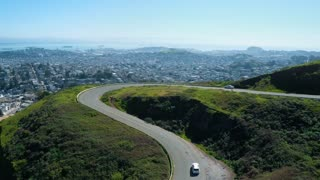 Cars Driving on Hillside Road in San Francisco