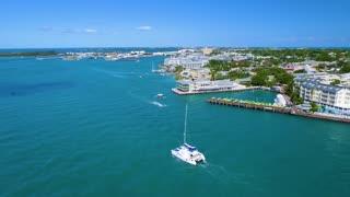Catamaran Motoring Past Resorts