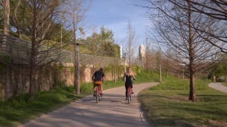 Couple Cycling in Houston Park Tracking Shot