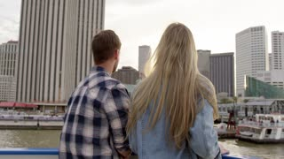 Couple Looks Towards New Orleans Skyline, on Mississippi River Riverboat