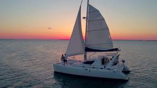 Couple on a Catamaran at Sunset