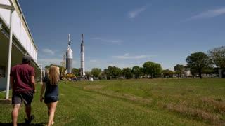 Couple Walking Towards Nasa Rocket Tracking Shot