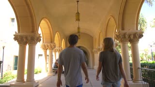 Couple Walks Through Balboa Park in San Diego