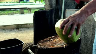 Cutting Up a Coconut With a Machete