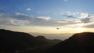 Drone at Sunset Over Lake Tahoe Tracking Shot