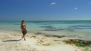 Girl Walking On White Sand Beach
