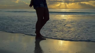 Girl Walking On White Sand Beaches of Tulum at Sunset