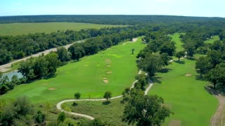 Golf Green Next to Water by Aerial Drone