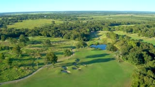 Green Golf Course with Small Ponds