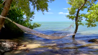 Hammock Hung from Trees Over the Water
