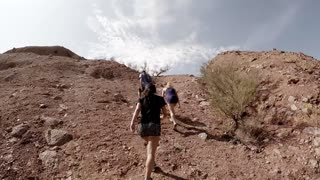 Hikers Climbing a Desert Mountain
