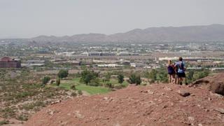 Hikers Climbing a Desert Mountain