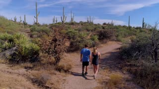 Hikers on a Trail Through the Desert
