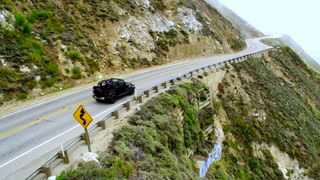 Jeep on Cliffside Highway in Big Sur by Aerial Drone
