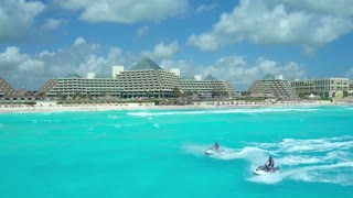 Jetskis Pass by Caribbean Resort by Aerial Drone