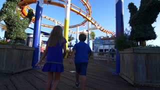 Kids Under the Santa Monica Pier Roller Coaster
