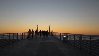 LA Beach Boardwalk Sunset Tracking Shot
