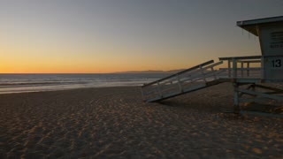 LA Beach Lifeguard Shack at Sunset Tracking Shot