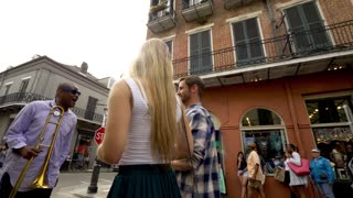 Laughing Couple Talks to Street Musician in French Quarter (360)