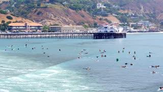 longboard Surfers in Front of the Malibu Pier