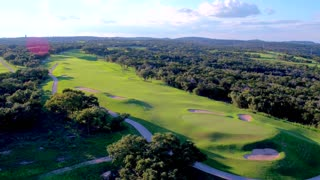 Lush Green Golf Course Flyover by Aerial Drone